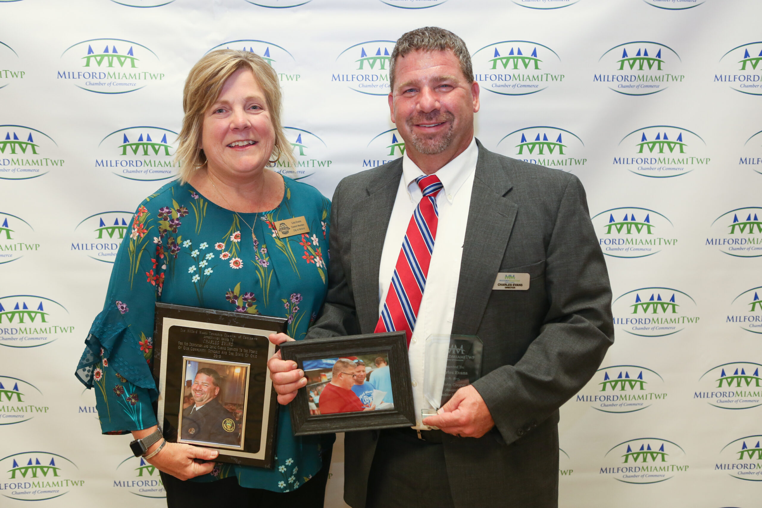 Charlie Evans with wife Lisa receiving the Chief John Cooper Award & the Wall of Fame Award